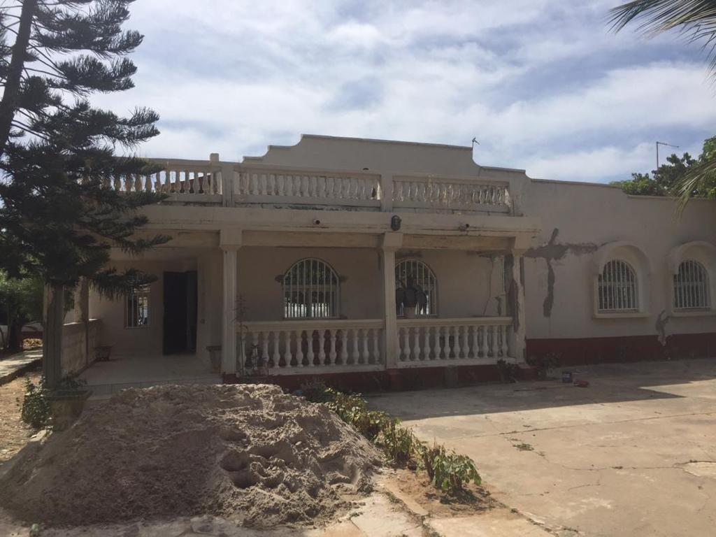 Three bedrooms with two master bedrooms house and a boys quarter in a big land space for sale at a reasonable frice of D4million