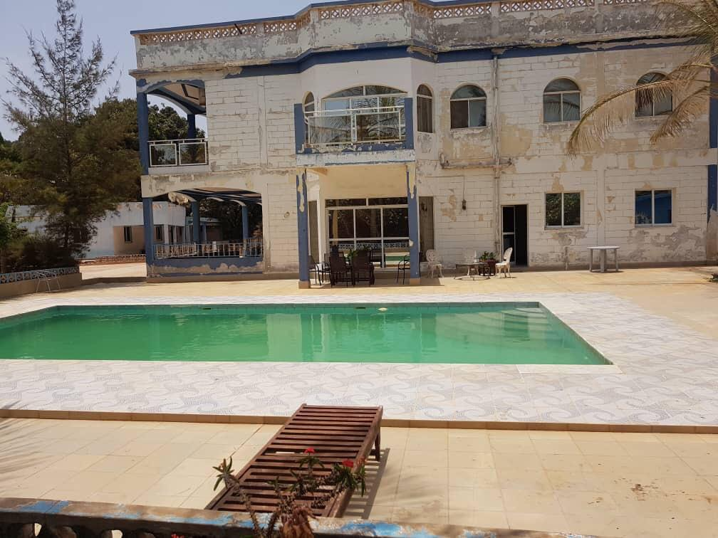 HOUSE FOR SALE AT BRUFUT WITH A SWIMMING POOL AND THE LAND SIZE IS 60 X 50 METERS