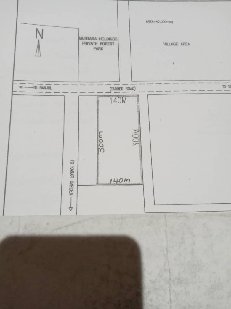 BIG EMPTY LAND FOR SALE AT BONTO 300 x 140 METER ON THE HIGHWAY PRICE D1.5MILLION